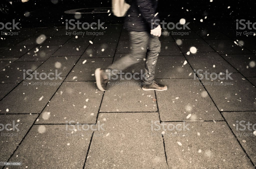 Walking Home in Falling Snow stock photo