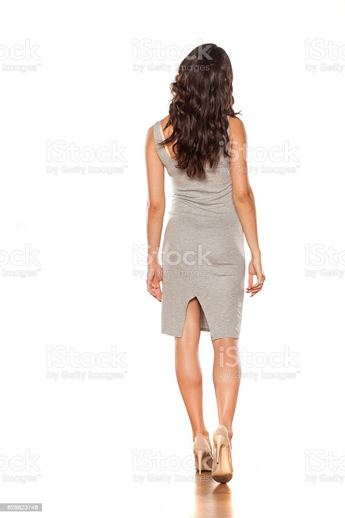 walking in a short dress and high heels stock photo
