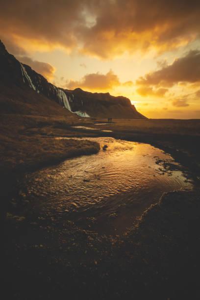 Walking in a winter sunrise in Iceland stock photo