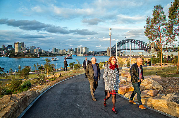 walking in barangaroo reserve - new parkland on sydney harbour - barangaroo stock photos and pictures