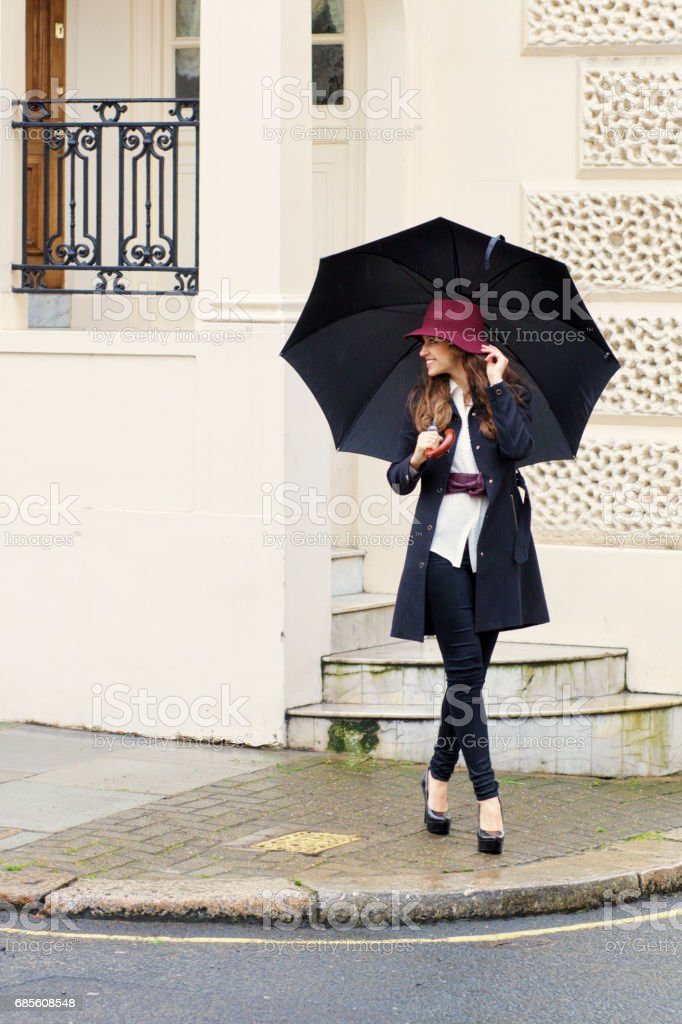 Walking in Belgravia Russian outdoor girl fashion model umbrella stock photo