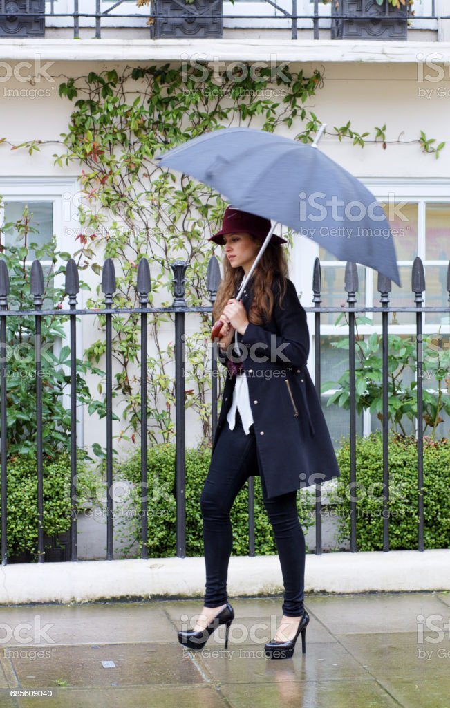 Walking in Belgravia Russian outdoor girl fashion model umbrella 免版稅 stock photo