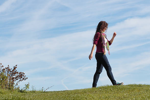 walking along grassy horizon beautiful shapely canadian outdoor girl - whiteway canadian outdoor girl stock photos and pictures