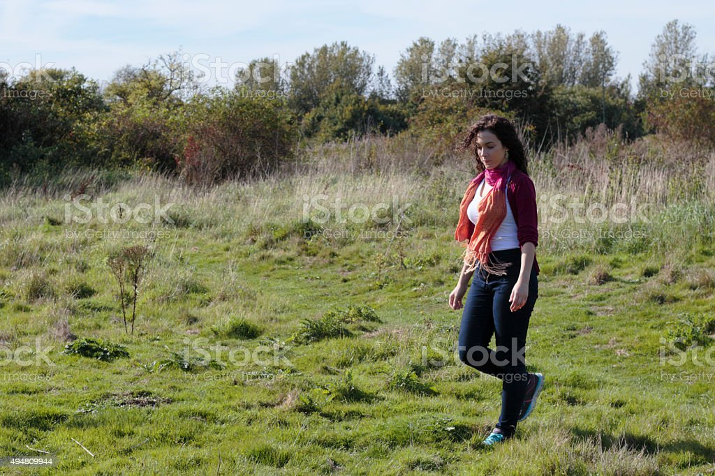 Walking on Mitcham Common beautiful shapely Canadian outdoor girl stock photo