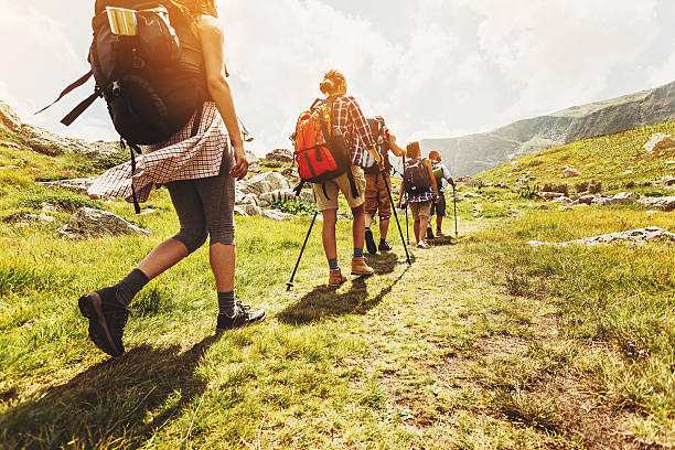 walking in line in the mountain - hiking stock photos and pictures