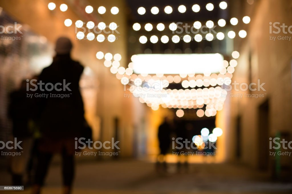 walking in the alley at night stock photo