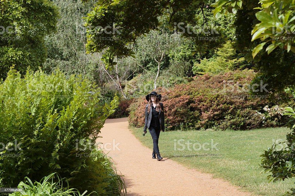 Latvian outdoor girl model walking in Isabella Plantation stock photo