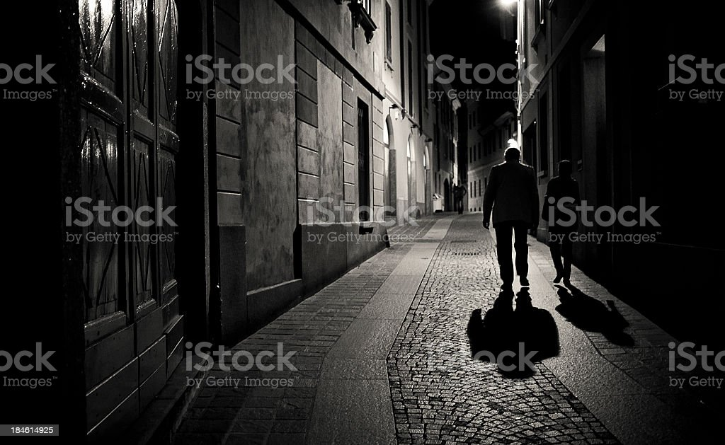 walking in the night stock photo