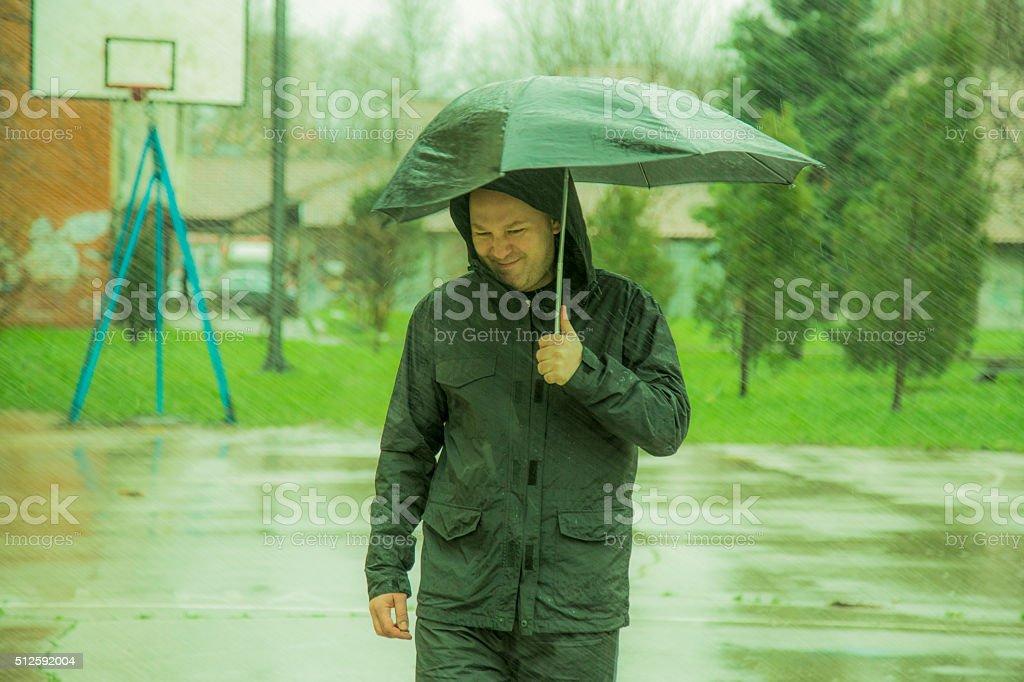 Walking in the rain stock photo