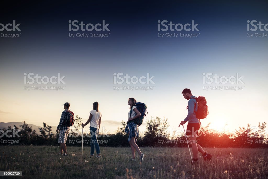 Walking in the sunglow hikers stock photo