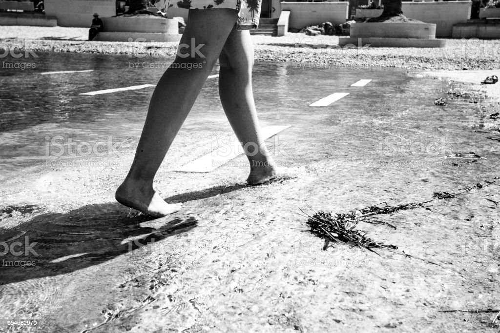 Walking in water stock photo