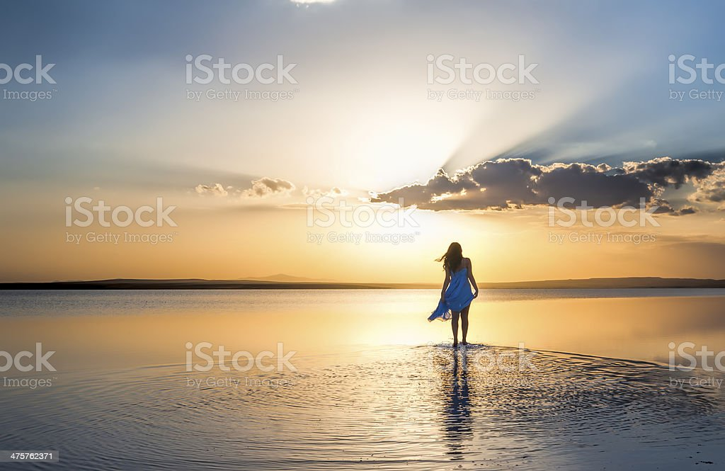 Walking into sunset stock photo