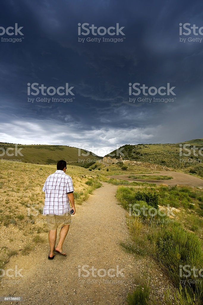 Walking into the Storm royalty-free stock photo