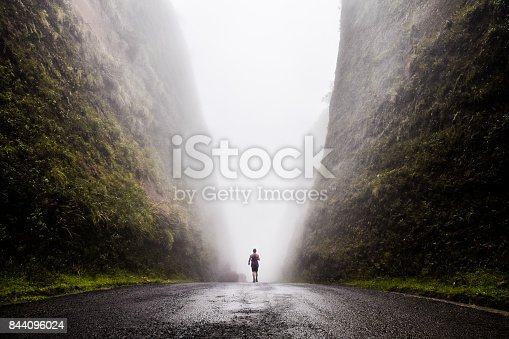 istock Walking into the unknown, walking between two huge cliffs of rock while a cloud passes in between of them, Urubici, South of Brazil, Brazil, South America. 844096024