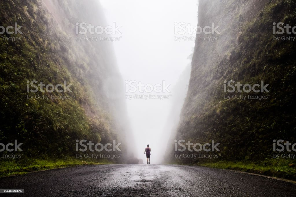 Walking into the unknown, walking between two huge cliffs of rock while a cloud passes in between of them, Urubici, South of Brazil, Brazil, South America. stock photo