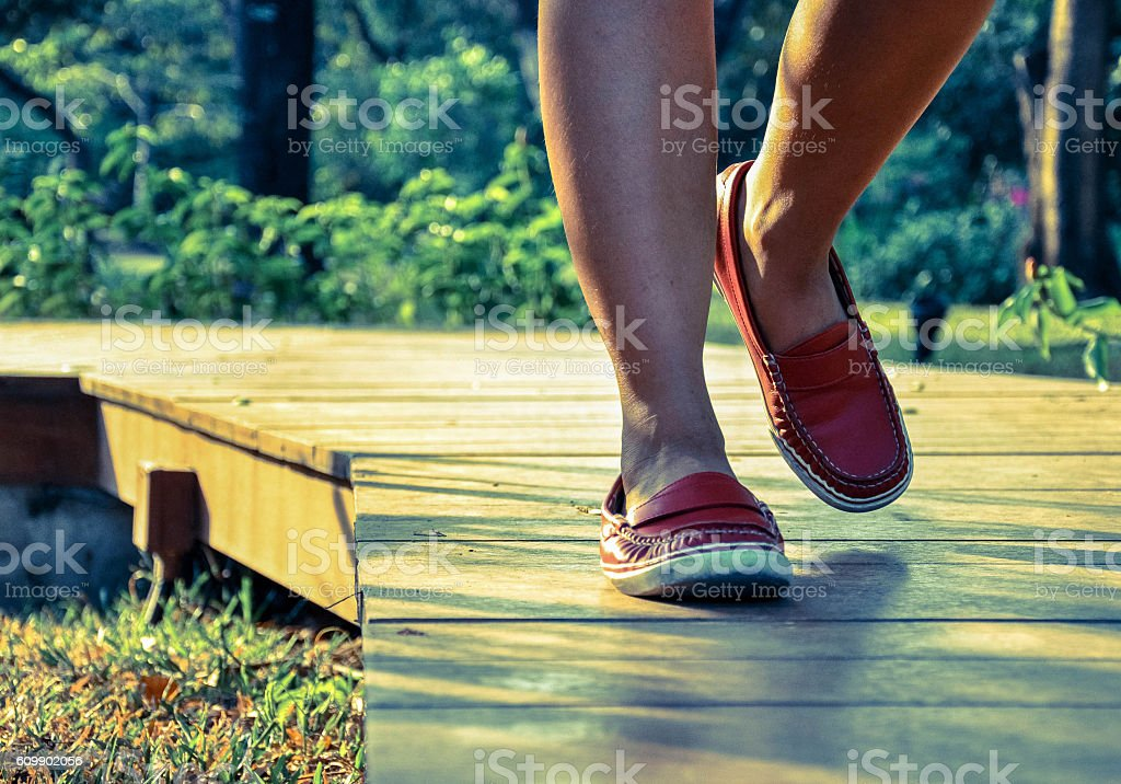 ff77c7a65 Walking Legs Of Lady In Red Shoes Stock Photo & More Pictures of ...
