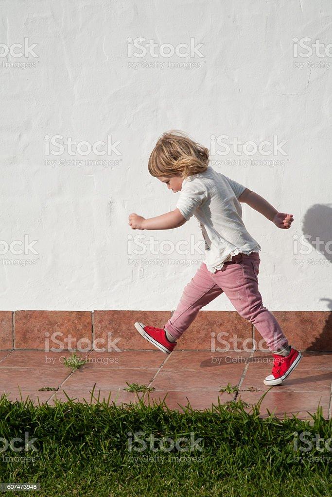 walking little child in garden over white wall stock photo