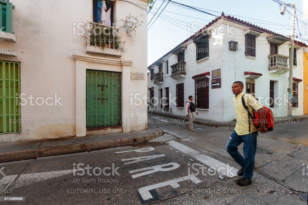 Walking man in Cartagena stock photo