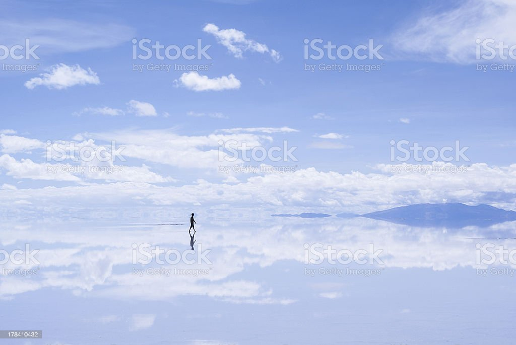 Walking Man in Salar de Uyuni, Bolivia stock photo
