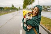 istock Walking my dog on a rainy day 1280044511