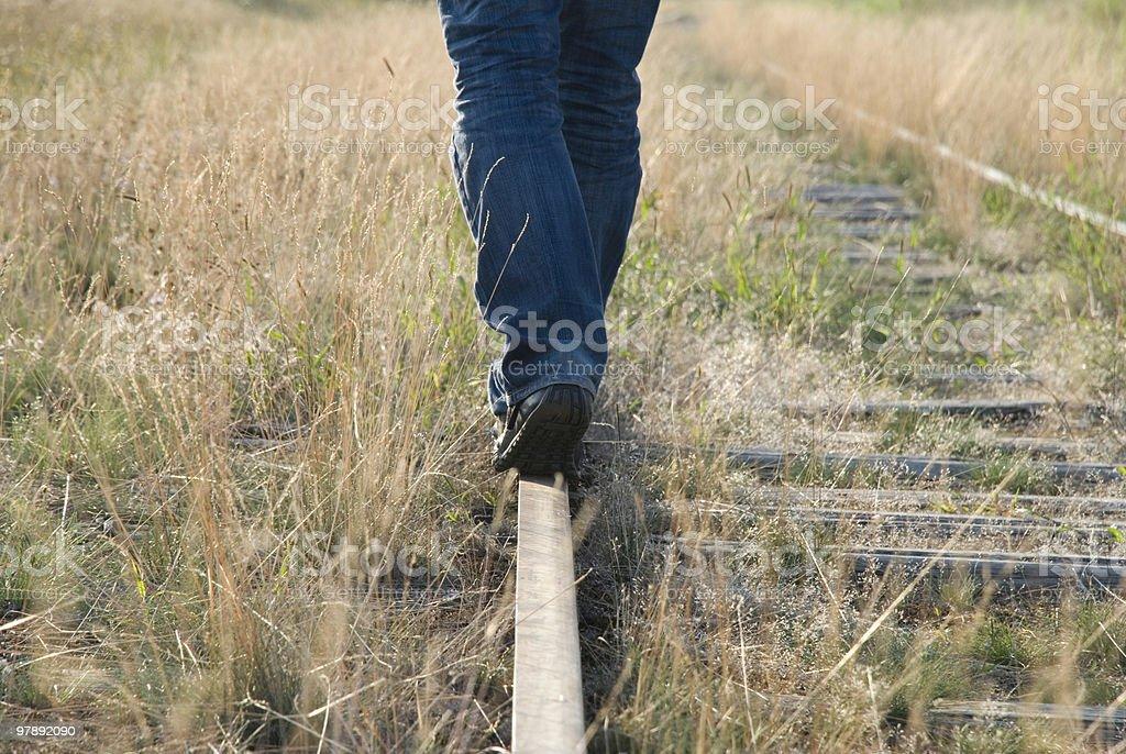 Walking on a rail royalty-free stock photo