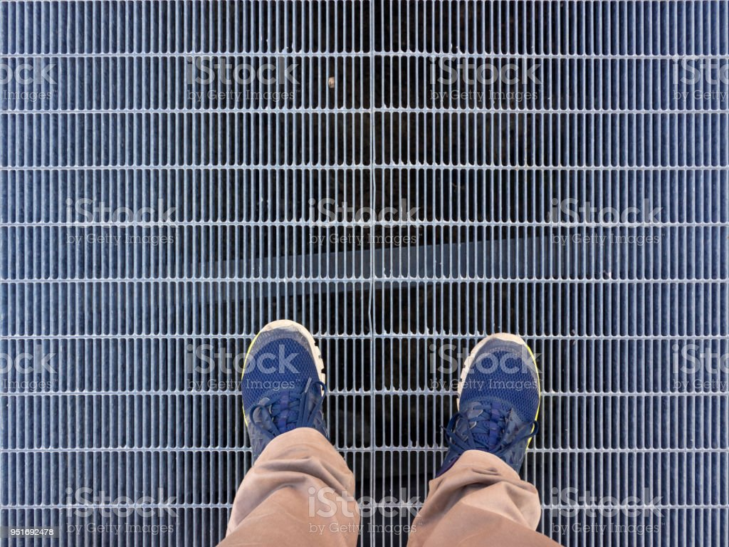 Walking on an iron grate - foto stock