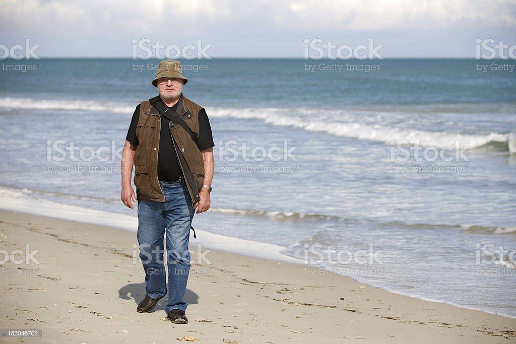 Walking on Beach stock photo