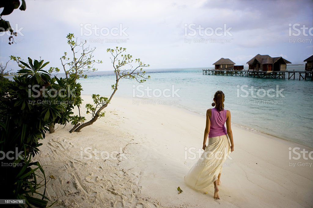 Walking on beach royalty-free stock photo