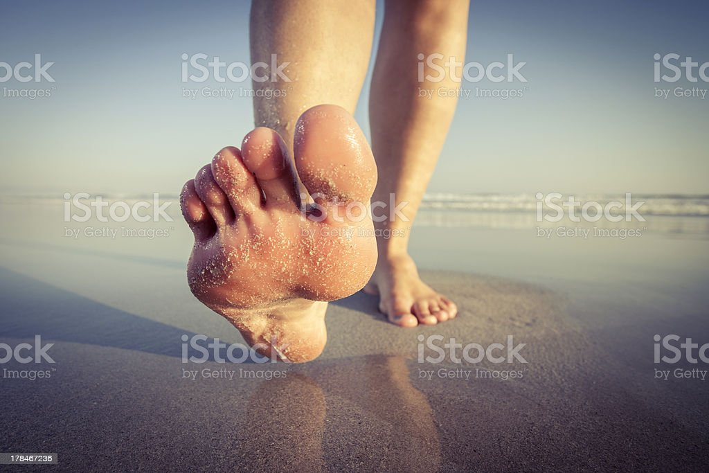 Walking on beach stock photo
