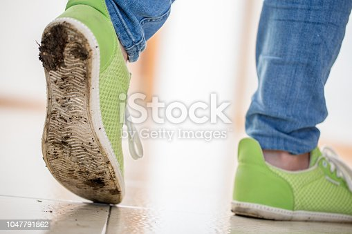 Walking on Clean Floor With Dirty Shoes.