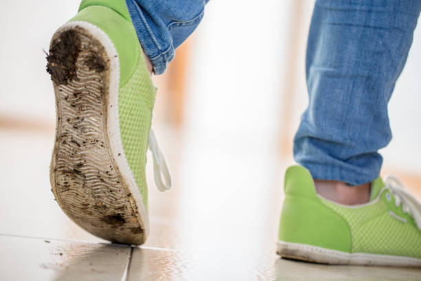 walking on clean floor with dirty shoes - dirty shoes stock photos and pictures