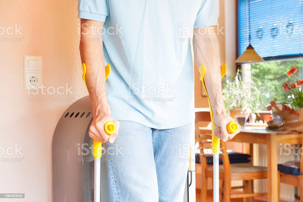 Walking on crutches royalty-free stock photo