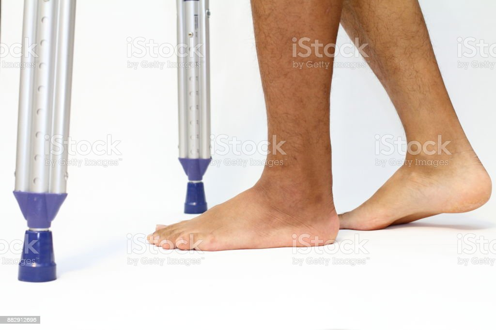 walking on crutchs stock photo