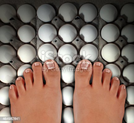 Walking on eggs as an emotional concept of anxiety and stress for treading carefully on a dangerous fragile path as a metaphor for challenges risk and security with barefoot human feet stepping on white eggshells.