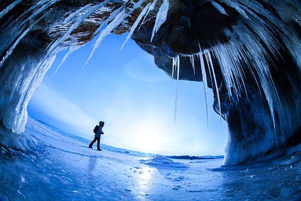 walking on frozen lake - siberië stockfoto's en -beelden