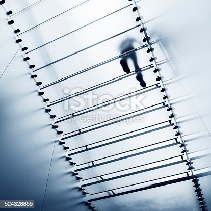 One person walking on modern glass staircase.