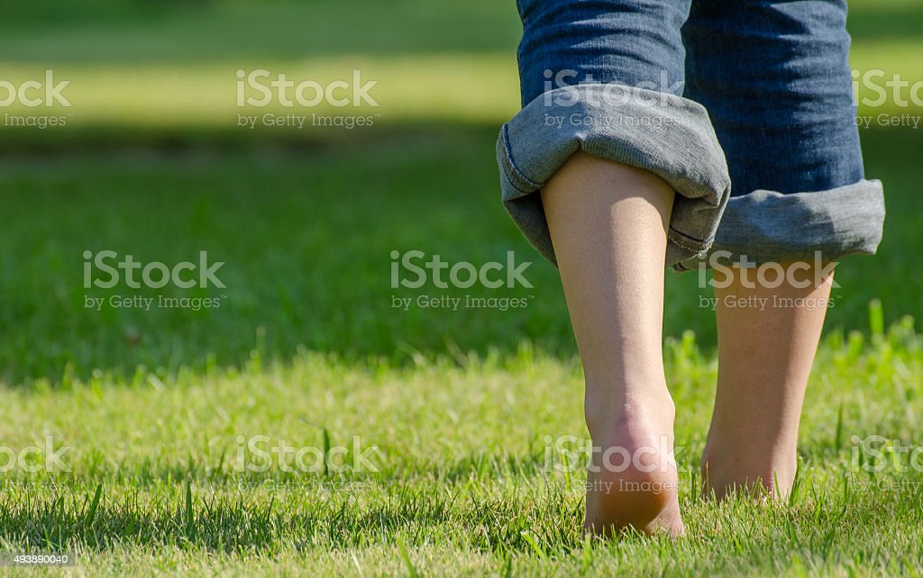 walking on grass stock photo