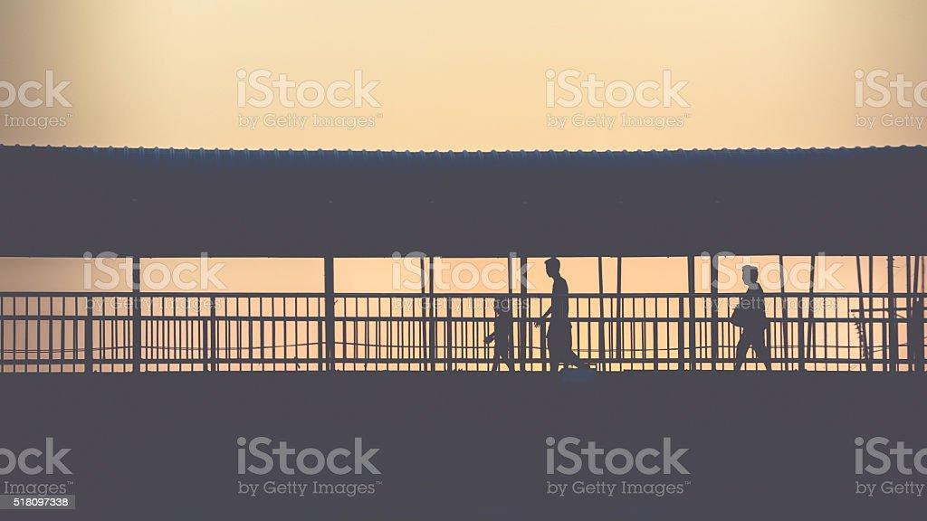 Walking on overpass stock photo