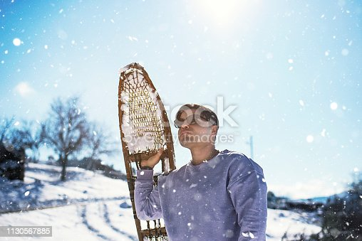 Walking on snow with wooden snowshoes