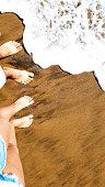 walking on the beach barefoot