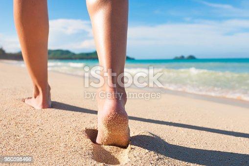 istock Walking on the beach 950598466