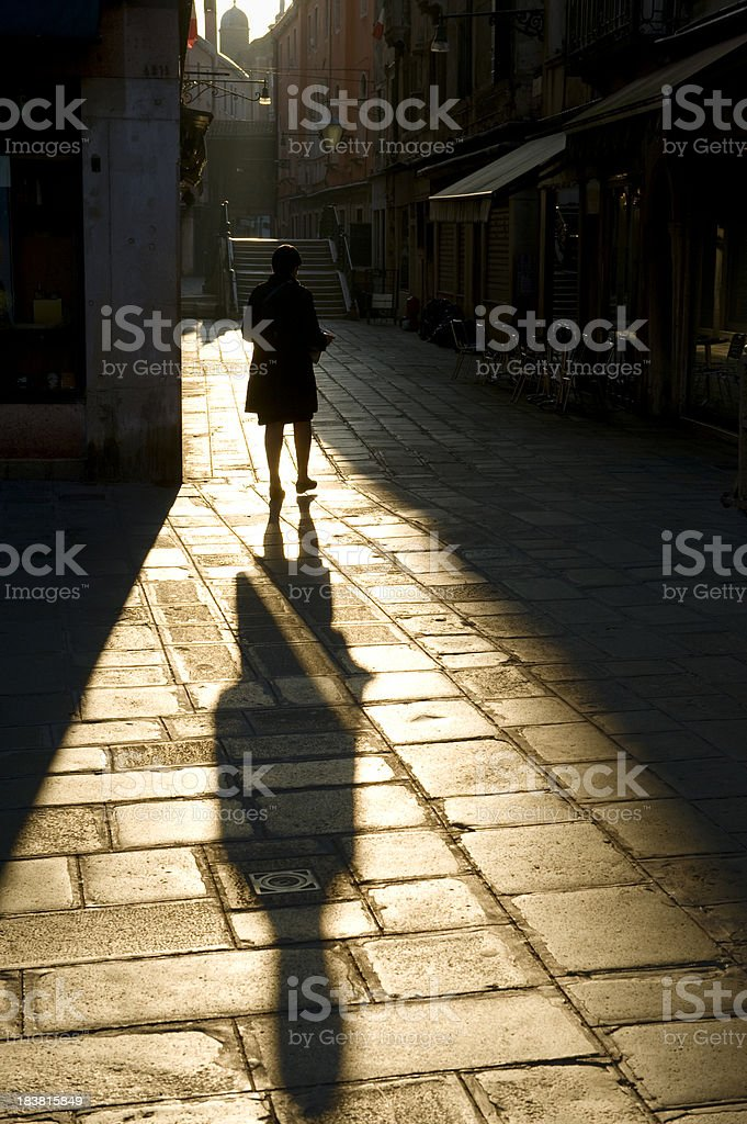 walking on the cobblestone street stock photo