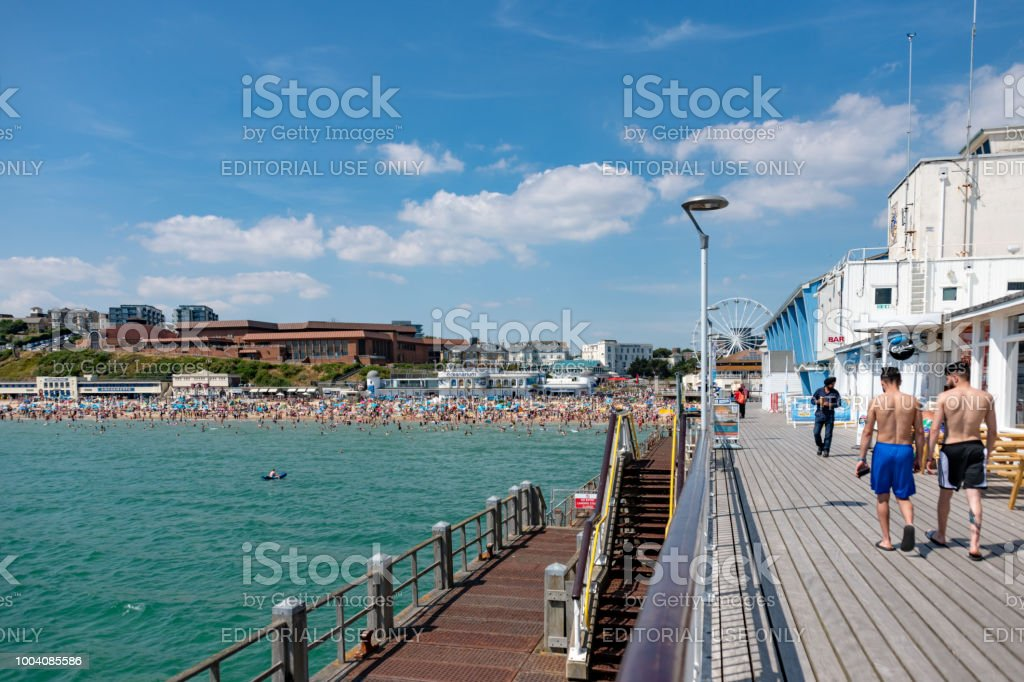 Walking on the pier in Bournemouth on a summers day stock photo