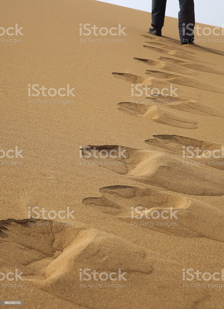 walking on the sand dune royalty-free stock photo
