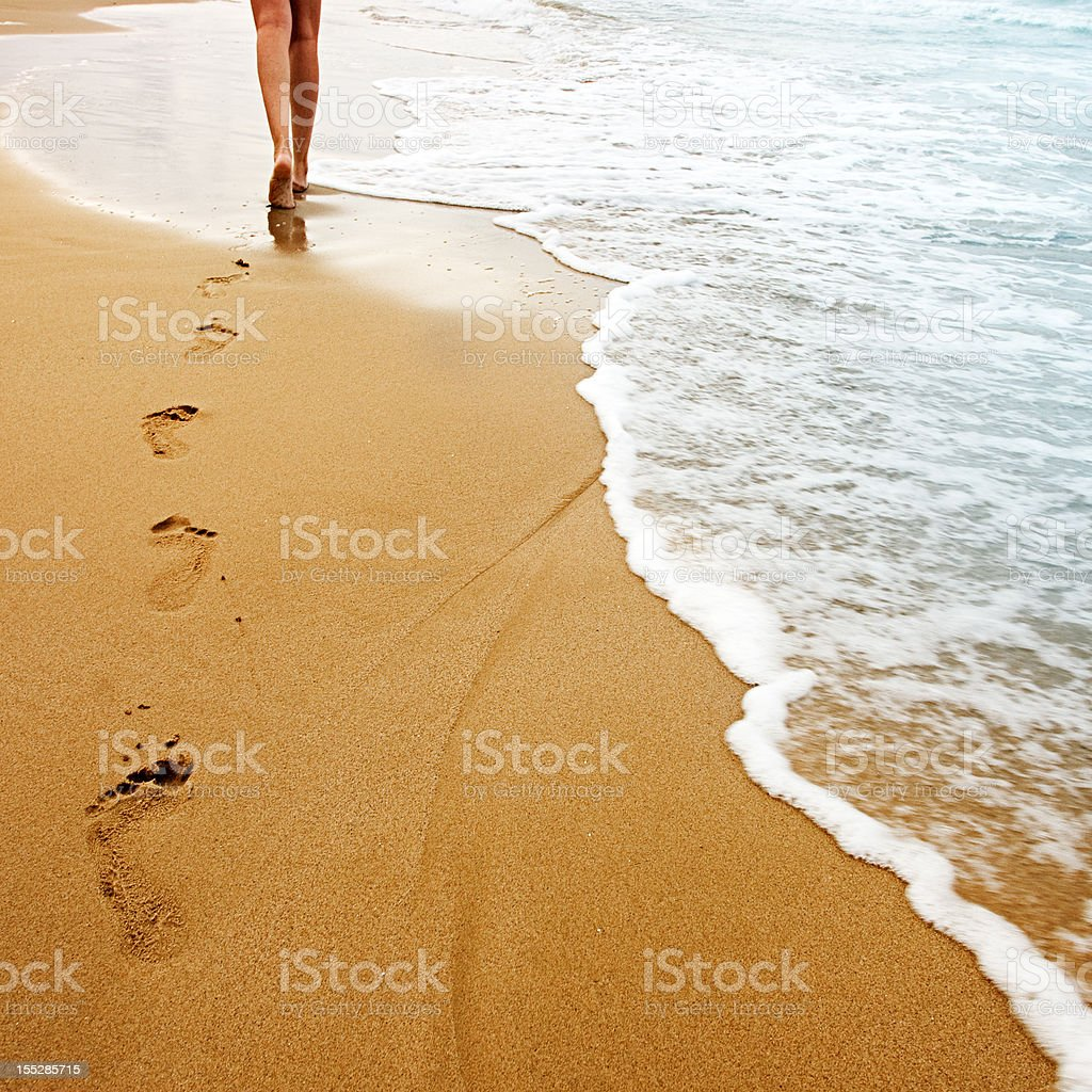Walking on the sand stock photo