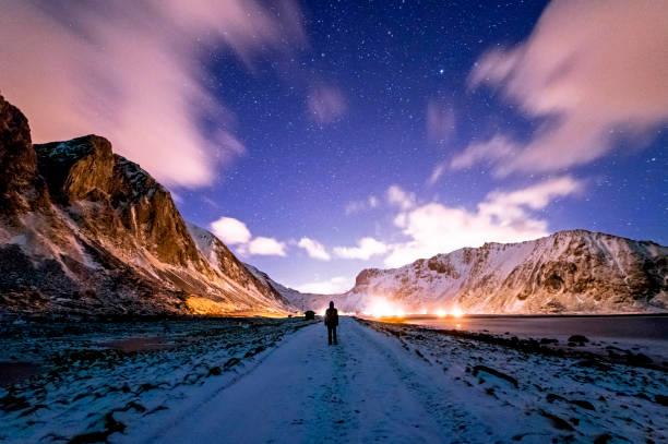 Walking on the Unstad Beach at Night stock photo