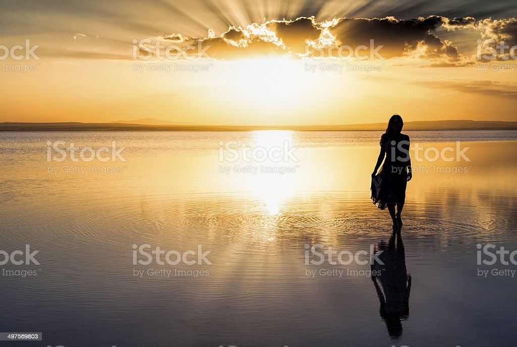 Walking on water Young woman walking on water Active Lifestyle Stock Photo