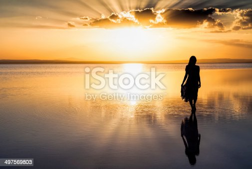 Young woman walking on water