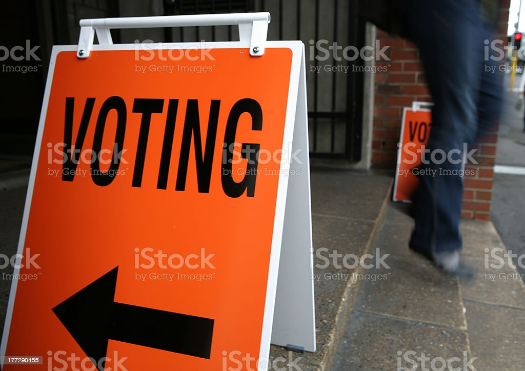 Walking out from polling facility on election day stock photo