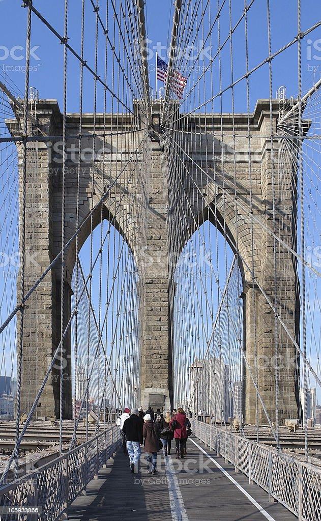 walking over Brooklyn Bridge royalty-free stock photo